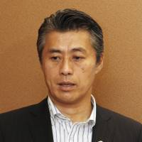 Democratic Party lawmaker Goshi Hosono is interviewed in the Diet on Tuesday. | KYODO