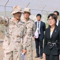 Defense Minister Tomomi Inada is briefed Monday by senior Self-Defense Forces personnel in Djibouti on their anti-piracy mission off Somalia. | KYODO