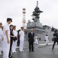 Inada visits U.S. aircraft carrier, inspects MSDF base in Yokosuka