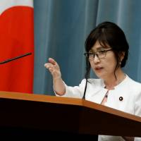 Tomomi Inada, who was appointed defense minister in Wednesday's Cabinet reshuffle, speaks at a news conference at the Prime Minister's Office in Tokyo the same day. | REUTERS