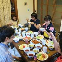 Students and staff of the nonprofit organization Koko eat dishes they cooked by themselves in Suita, Osaka Prefecture, in this undated photo. | KOKO / VIA KYODO