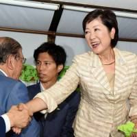 Yuriko Koike is all smiles at her campaign office in Toshima Ward on Sunday night soon after she was assured of victory in the Tokyo gubernatorial election. | SATOKO KAWASAKI