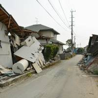 Damaged homes remain untouched Sunday in the town of Mashiki four months after a killer earthquake hit Kumamoto Prefecture. | KYODO