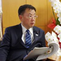 Education minister Hirokazu Matsuno is interviewed on Friday in Tokyo. He read from a government text. | REIJI YOSHIDA