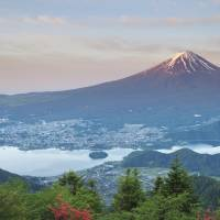 Mount Fuji and Lake Kawaguchiko are seen on a summer day. Japan celebrates Mountain Day, the newest public holiday, on Thursday. | ISTOCK