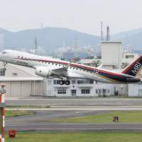 A Mitsubishi Regional Jet takes off Sunday from Nagoya Airport. | KYODO