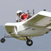 The M-02J glider, modeled after the Mehve, a flying machine seen in the Hayao Miyazaki anime 'Nausicaa of the Valley of the Wind,' conducts a public test flight in Takikawa, Hokkaido, on Sunday.   KYODO