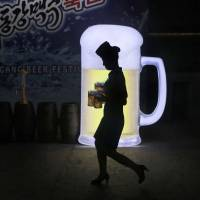 A waitress carries mugs of beer during the Taedonggang Beer Festival in Pyongyang on Aug. 21. The festival, the first of its kind in North Korea, was held as a promotional event for domestic beer. | AP