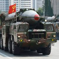 A Rodong-type missile is displayed during a military parade in Pyongyang's Kim Il Sung Square in July 2013. | KYODO