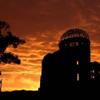 The Atomic Bomb Dome is seen silhouetted in Hiroshima in May ahead of U.S. President Barack Obama's historic visit to the city. | BLOOMBERG
