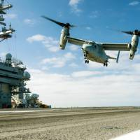 A MV-22B Osprey lands on the aircraft carrier USS Carl Vinson on June 12 in the Pacific Ocean. | U.S. NAVY / VIA KYODO