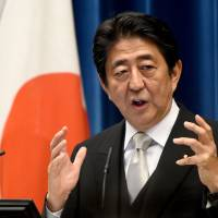 Prime Minister Shinzo Abe speaks at a news conference at the prime minister's official residence in Tokyo on Wednesday following his Cabinet reshuffle the same day. | AFP-JIJI