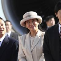 Crown Prince Naruhito (left), Crown Princess Masako (center) and Prince Akishino see off Emperor Akihito and Empress Michiko at Haneda airport in Tokyo on Nov. 30, 2013. | AP