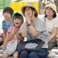 Fans gather to watch Japan's Olympic athletes on giant public screens
