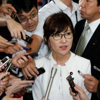 Tomomi Inada talks to reporters on Aug. 3. | REUTERS