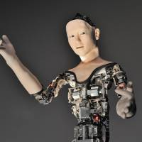 Alter, a new robot developed by researchers at Osaka University and the University of Tokyo, is unveiled at the National Museum of Emerging Science and Innovation (Miraikan) in Tokyo's Koto Ward on July 29. | YOSHIAKI MIURA