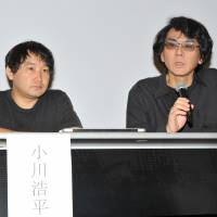 Osaka University professor Hiroshi Ishiguro holds a news conference July 29 at the National Museum of Emerging Science and Innovation (Miraikan) in Tokyo's Koto Ward, as Osaka University assistant professor Kohei Ogawa looks on. | YOSHIAKI MIURA