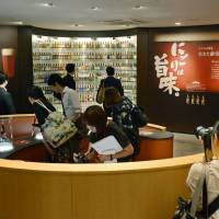 Members of the media check out a sake factory to be opened next week by Kizakura Co. in Kyoto on Thursday. The brewery plans to offer free tours for foreign tourists.   KYODO