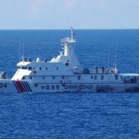 Japan protests after swarm of 230 Chinese vessels enters waters near Senkakus