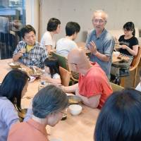 Residents of Collective House Seiseki in the Tokyo city of Tama dine together in June. | KYODO