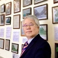 Ikuo Tsunematsu, who runs a museum focused on famed novelist Soseki Natsume in London, is pictured at the museum in March. | COURTESTY OF IKUO TSUNEMATSU / VIA KYODO