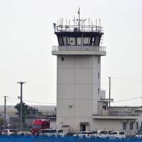 The lone controller on duty at Tokushima Airport's control tower directed a JAL jet to land on a runway onto which a maintenance vehicle had been driven in April 2015.. | KYODO