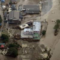 Nine people were found dead near a nursing home in Iwaizumi, Iwate Prefecture, Wednesday after a river burst its banks and flooded the facility. | KYODO