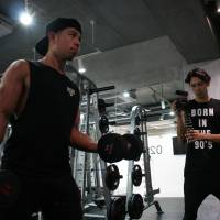 Do you lift?: Shun Kaneko is filmed during a work-out session for his YouTube channel Kanekin Fitness. The 27-year-old swapped cigarettes and alcohol for protein and exercise a while back and used YouTube to help him do it. | ALISA YAMASAKI