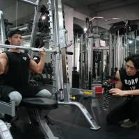 Subscribing to a healthy lifestyle: Shun Kaneko works out for his Kanekin Fitness channel on YouTube. He says via the website he has received a lot of questions from people about where to start when it comes to exercise. | ALISA YAMASAKI