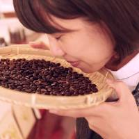 Mieko Kuchiba, owner of a coffee shop cum gallery called Maruchan, painstakingly roasts beans by hand before grinding them and filtering them through a coffee 'sock' | KIT NAGAMURA