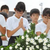 Students of morality: Schoolchildren in Nagasaki pray at an Aug. 9 ceremony marking the 71st anniversary of the dropping of the atomic bomb on their city. From 2018, moral education will be part of the curriculum at elementary and junior high schools, but according to whose moral code?   KYODO