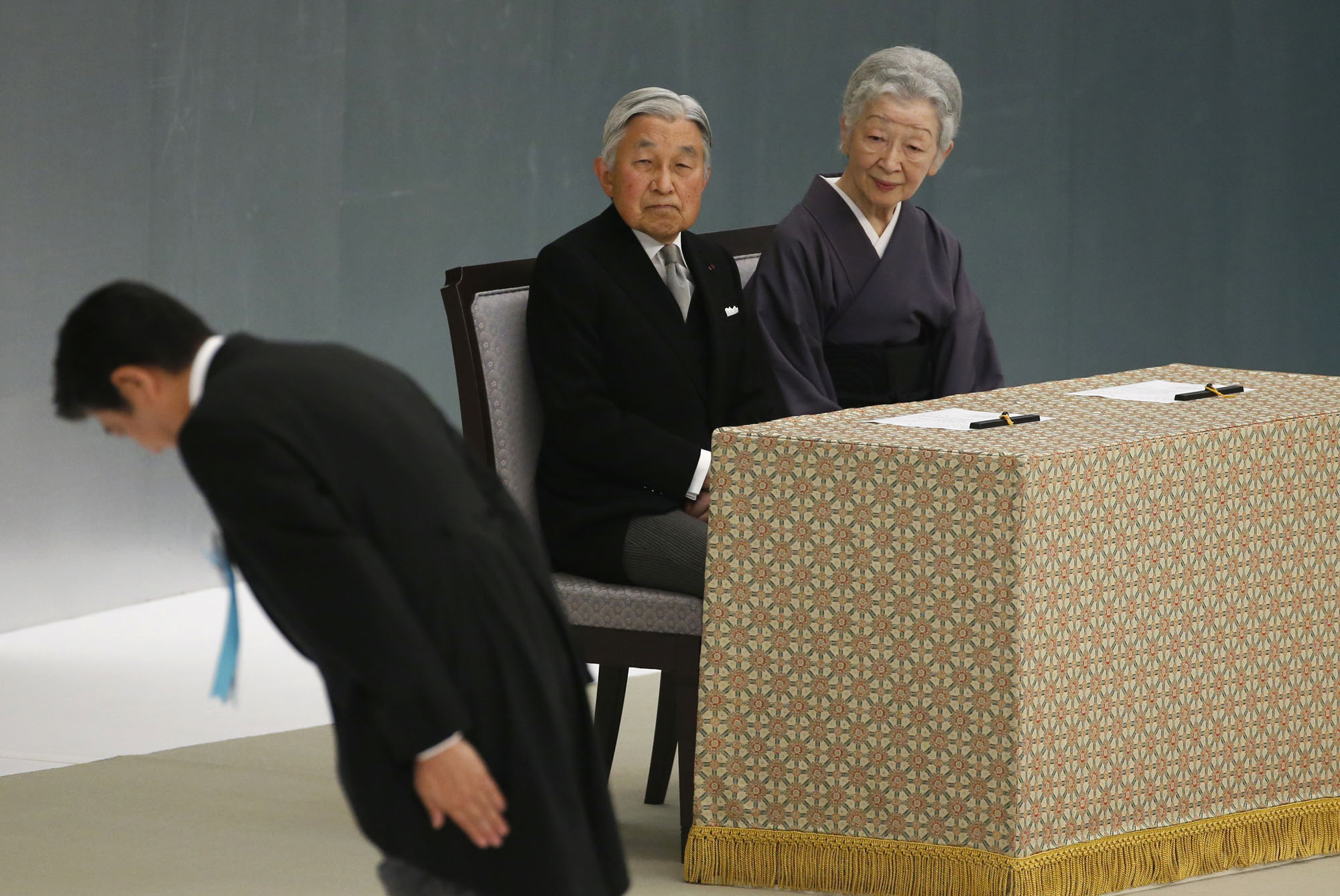 Symbols of state: Prime Minister Shinzo Abe bows before the main altar as Emperor Akihito and Empress Michiko watch during a memorial service at Nippon Budokan Hall in Tokyo on Aug. 15, the 71st anniversary of Japan's surrender at the end of World War II . | AP