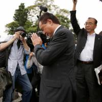 Stories untold: Kanagawa Gov. Yuji Kuroiwa prays for victims of the deadly attack on July 26 on a home for people with disabilities in Sagamihara, Kanagawa Prefecture. | REUTERS