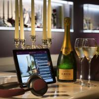 Champagne bar pays bubbly tribute; buffet offers view of ancient garden; tasting a forest of summer desserts