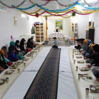 Group meals like this one at the Tokyo gurdwara, served for free to all attendees no matter their faith, are an important feature of Sikhism. | MEGHA WADHWA