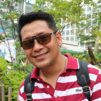 Dennis Bernal, Restaurant staff, 43 (Filipino): With all my friends playing it, I felt like I had to, in order to fit in. It's getting more popular everyday, especially with the older generations. I'll admit, it's addicting, so it requires a lot of self-control, but I don't regret it — it makes me feel young again! | NAOMI SCHANEN