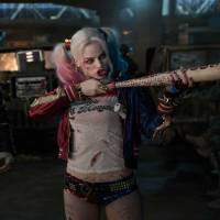 On the mean side: Adewale Akinnuoye-Agbaje as Killer Croc and Margot Robbie as Harley Quinn in 'Suicide Squad.' | © 2016 WARNER BROS. ENTERTAINMENT INC. AND RATPAC-DUNE ENTERTAINMENT LLC