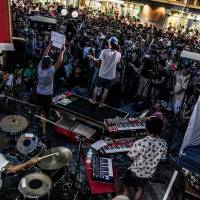 Being heard: Musician and parliamentary candidate Yohei Miyake addresses a crowd at Shinjuk Station last month. Author Noriko Manabe examines the mix of music and politics in Japan in her latest book, 'The Revolution Will Not Be Televised: Protest Music After Fukushima.' | AISUKE ITOU