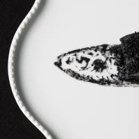 In the black: One of Yoji Tokuyoshi's signature dishes, called 'gyotaku,' is based on the Japanese tradition of making prints of fish with ink.