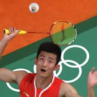 Chen claims men's badminton title