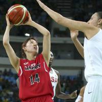 Japan's Sanae Motokawa shoots while being defended by U.S. guard Diana Taurasi during their Olympic quarterfinal game on Tuesday in Rio de Janeiro. | REUTERS