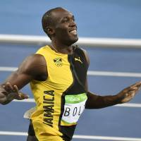 Jamaica's Usain Bolt wins the men's 100-meter final during the athletics competition of the 2016 Summer Olympics at the Olympic stadium in Rio de Janeiro Sunday. | AP