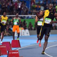 Bolt looking good for 'triple-triple' after 100-meter success