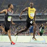 Bolt cruises into 200 final; U.S. women sweep 100 hurdles