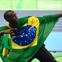 Bolt ascends to true greatness with 'triple-triple' Olympic haul