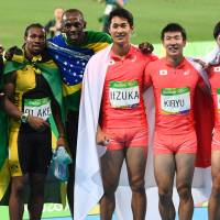 Bolt completes triple-triple with Jamaica's gold in 4x100 relay; Japan makes history by taking silver