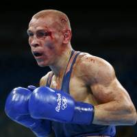 Russian boxer at center of judging controversy out of Olympics with injury