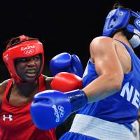 Middleweight Shields repeats as Olympic boxing champion