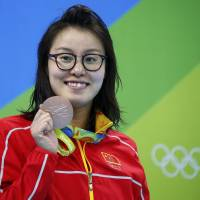 In China, a more forgiving public embraces fewer Olympic gold medals