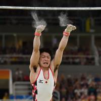 Japan overcomes errors to reach men's gymnastics team final